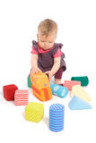 Baby palying with toy blocks. Little baby girl (9 months old) playing with toy blocks. Isolated on white. Toys are property released stock images