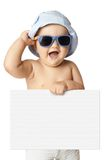 Baby in panama and sunglasses holding a banner. Isolated Royalty Free Stock Photo