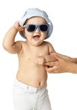 Baby in panama and sunglasses laughing Stock Image