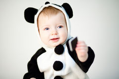 Baby in panda costume Royalty Free Stock Photo