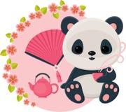 Baby panda is drinking oriental tea Stock Photos