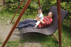Baby and papa Stock Image