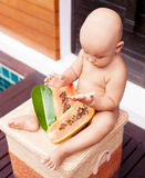 Baby with papaya Royalty Free Stock Photography