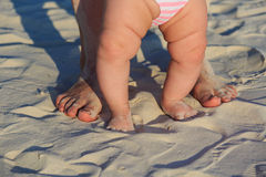 Baby and parent feet on sand beach Royalty Free Stock Photo