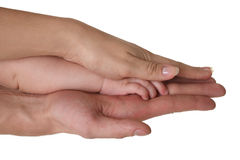 Baby and parent holding hands Royalty Free Stock Images