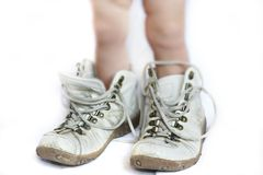 Baby in parent's boots. Close up of baby in parent's boots Royalty Free Stock Photo