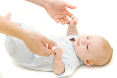 Baby and parent's hands. Over white Royalty Free Stock Image