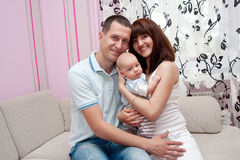 Baby with parents Stock Photos