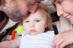 Baby parents family attention frowning Royalty Free Stock Photography