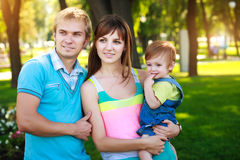 Portret baby with parents in a beautiful park Royalty Free Stock Photos