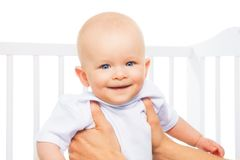 Baby in parents hands Royalty Free Stock Image