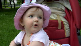 Baby in park stock video footage