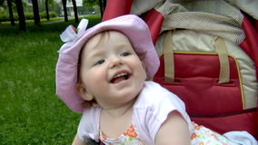 Baby in park stock footage