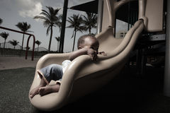 Baby on a park slide Stock Photography