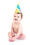 Baby party. Laughing baby wearing party hat Stock Images
