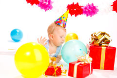 Baby in a party hat Stock Photo
