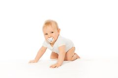 Baby with passy in his mouth wear white bodysuit stock photography