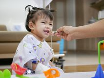 Baby patient playing toys with her family members. Selective focus of baby patient playing toys with her family members - playing with baby at a hospital to help stock photography