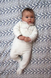 Baby on pattern background Royalty Free Stock Images