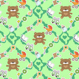 Baby pattern. Seamless pattern with child goods on the green backdrop Stock Image