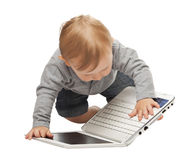 Baby with pc Stock Images