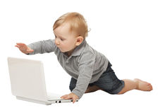 Baby with pc Stock Photos
