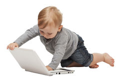 Baby with pc Stock Photography