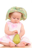 Baby and pear Stock Photography