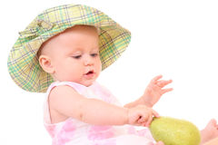 Baby and pear Royalty Free Stock Images
