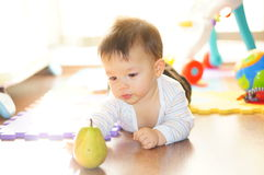 Baby and pear Royalty Free Stock Photo