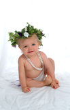 Baby With Pearls. Baby girl in white diaper cover, with string of pearls, on white background Royalty Free Stock Image