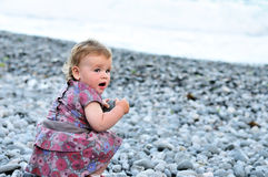Baby with pebble Royalty Free Stock Image