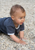 Baby in pebbles Royalty Free Stock Photos