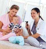 Baby with pediatrician and nurse Stock Photos