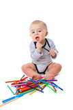 Baby with pencils Stock Photos
