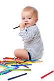 Baby with pencils Stock Photography