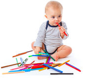 Baby with pencils Stock Photo