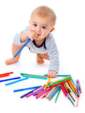 Baby with pencils Stock Images