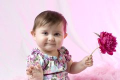 Baby with peony Royalty Free Stock Photography