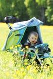 Baby in perambulator Royalty Free Stock Photo