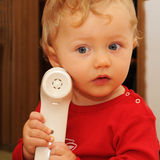 Baby at the phone Royalty Free Stock Photography