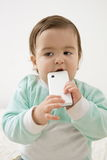 Baby with phone Stock Images