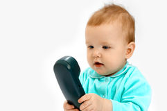 Baby and phone. On white Royalty Free Stock Photo
