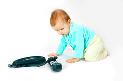Baby and phone. On white stock images