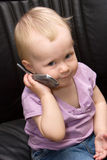 Baby on phone royalty free stock photography