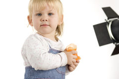 Baby in  photographic studio with lamp Royalty Free Stock Photos
