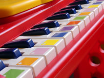 Baby piano. Plastic children's keyboard (small DOF Royalty Free Stock Image