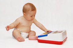 Baby with piano toy royalty free stock image