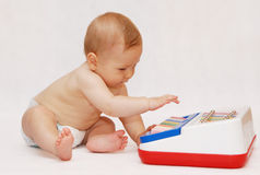 Baby with piano toy. Portrait of naked baby playing piano  toy Stock Photography