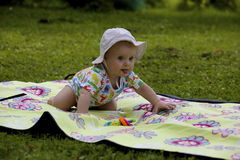 Baby on the picnic carpet in grass Stock Photos
